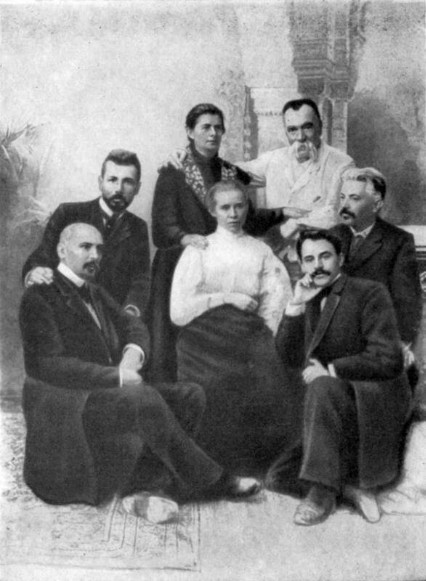 Image -- A group of Ukrainian writers during the unveiling of Ivan Kotliarevsky monument in Poltava (1903). Sitting (left to right): M. Kotsiubynsky, V. Stefanyk, L. Ukrainka, H. Khotkevych, V. Samiilenko. Standing: O. Pchilka, M. Starytsky.