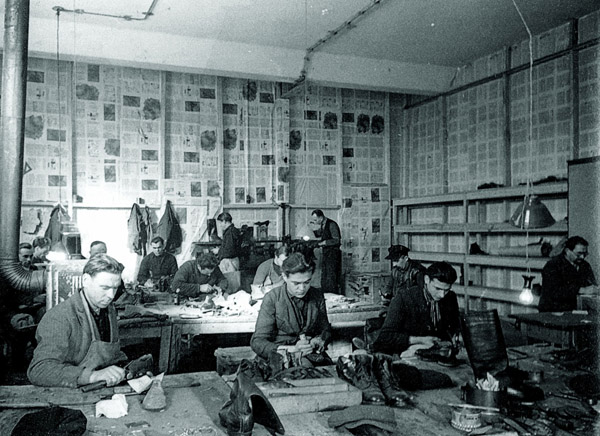 Image - A Ukrainian shoemakers workshop in a displaced persons camp in Germany.