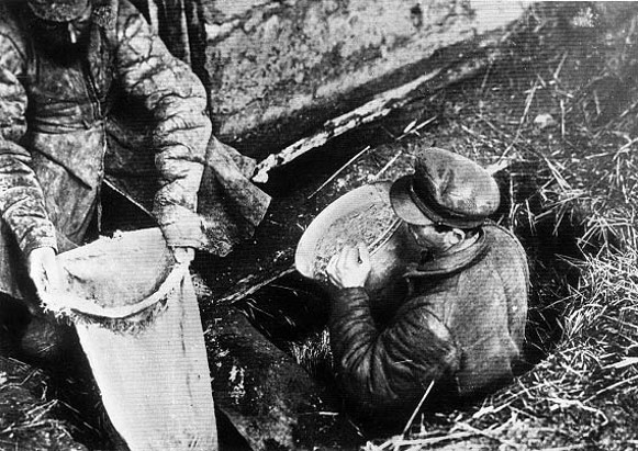 Image - Soviet officials confiscate grain from a peasant household in Ukraine (early 1930s).