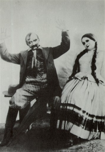 Image - Yosyp Hirniak and Valentyna Chystiakova in Les Kurbas' production of M. Kulish's Peoples Malakhii in Berezil (1928).