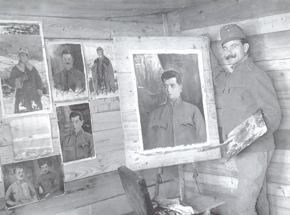 Image - Osyp Kurylas with his paintings.