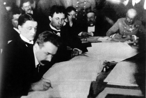 Image - Mykola H. Levytsky signing documents at the Brest-Litovsk Peace negotiations (1918).