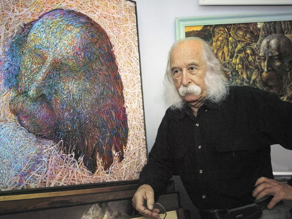 Image - Ivan Marchuk with his paintings.