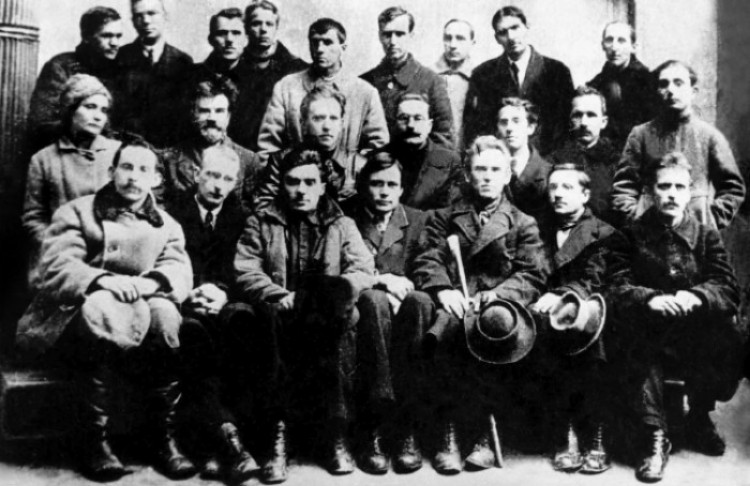 Image -- Yukhym Mykhailiv (third from right in the first row) among Ukrainian writers, painters, and composers (Kyiv, 1923).