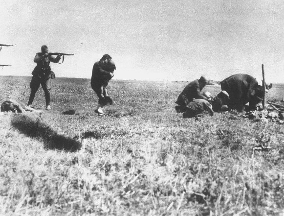 Image - Nazi soldiers killing Jews in Podilia region (1942).