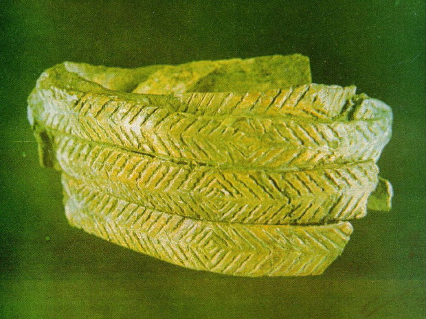 Image - A Paleolithic bracelet excavated in Mizyn, Chernihiv oblast, ca 15,000 BC (incised mammoth bone).