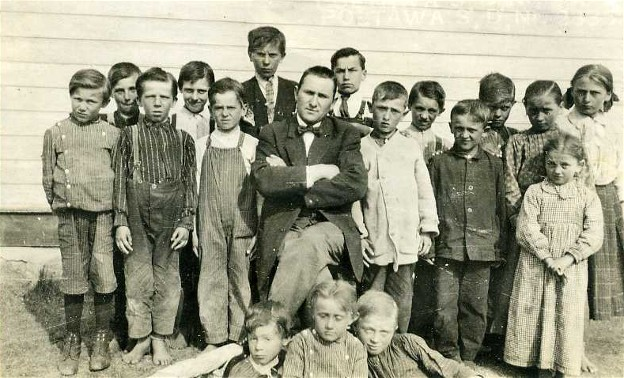 Image - A school teacher and his pupils in Poltawa School district in Cudworth, Saskatchewan (photo, courtesy of the Ukrainian Museum of Canada, Saskatoon Branch).