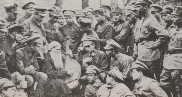 Image -- Sich Riflemen listening to a kobzar in Kyiv.