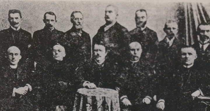 Image - Members of the supreme council of the Silskyi Hospodar in 1900. Sitting: Y. Folys, T. Dutkevych, Ye. Olesnytsky, I. Kyveliuk, S. Onyshkevych; standing: O. Harasevych, H. Tershakovets, K. Kakhnykevych, M. Kotsiuba, A. Korelia, H. Velychko, A. Zhuk.