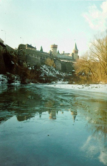 Image - The Smotrych River flowing past the Kamianets-Podilskyi castle.