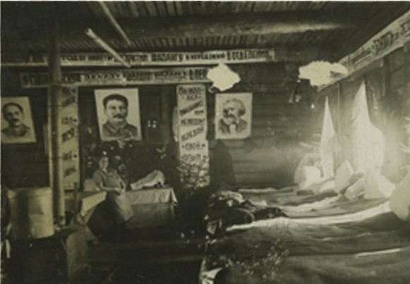 Image -- An interior of a barrack in a Soviet labor camp.