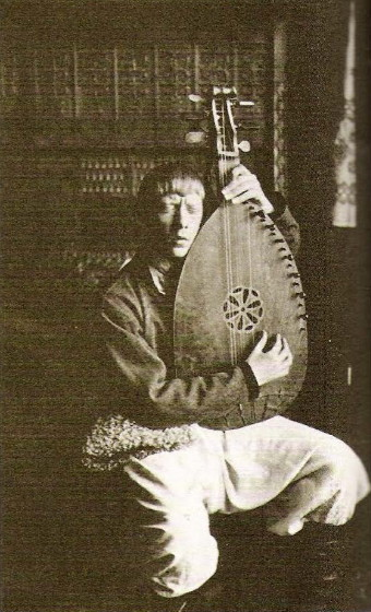 Image - Vladimir Tatlin performing as a blind bandura player (Berlin, 1914).