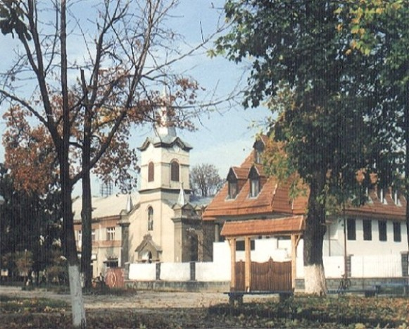 Image - Tiachiv: The Protestant Church (13th century, rebuilt in 18th century) and the parish building.