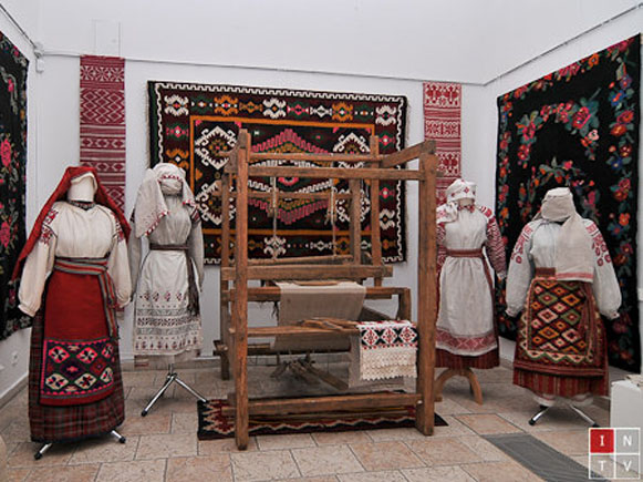 Image -- A traditional weaver's loom and folk dresses from Podilia.