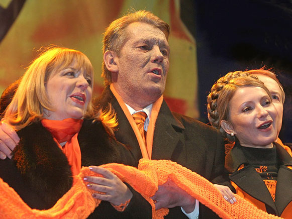 Image - The Orange Revolution: Kateryna and Viktor Yushchenko and Yuliia Tymoshenko.